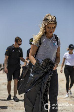 Christine 'GZ' Giampaoli Zonca, Hispano Suiza Xite Energy Team, helps to clean a beach