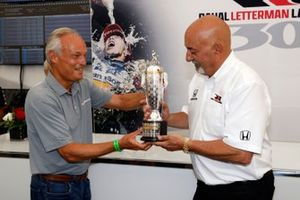 2020 Indy 500 winning team owner Bobby Rahal is presented with the Baby Borg-Warner Trophy by Fred Lissade, BorgWarner President and CEO