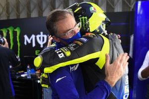 Valentino Rossi and Lin Jarvis during post-race farewell at Yamaha Factory Racing pit box