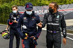 Sergio Perez, Red Bull Racing and Pole Sitter Lewis Hamilton, Mercedes walk to the Press Conference