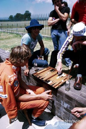 James Hunt, Hesketh, enjoys a game of backgammon in the paddock