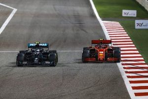 Valtteri Bottas, Mercedes F1 W11, battles with Charles Leclerc, Ferrari SF1000