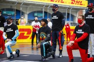 Lando Norris, McLaren, Lewis Hamilton, Mercedes-AMG F1, Max Verstappen, Red Bull Racing, Sebastian Vettel, Ferrari, and the other drivers stand and kneel in support of the End Racism camapaign
