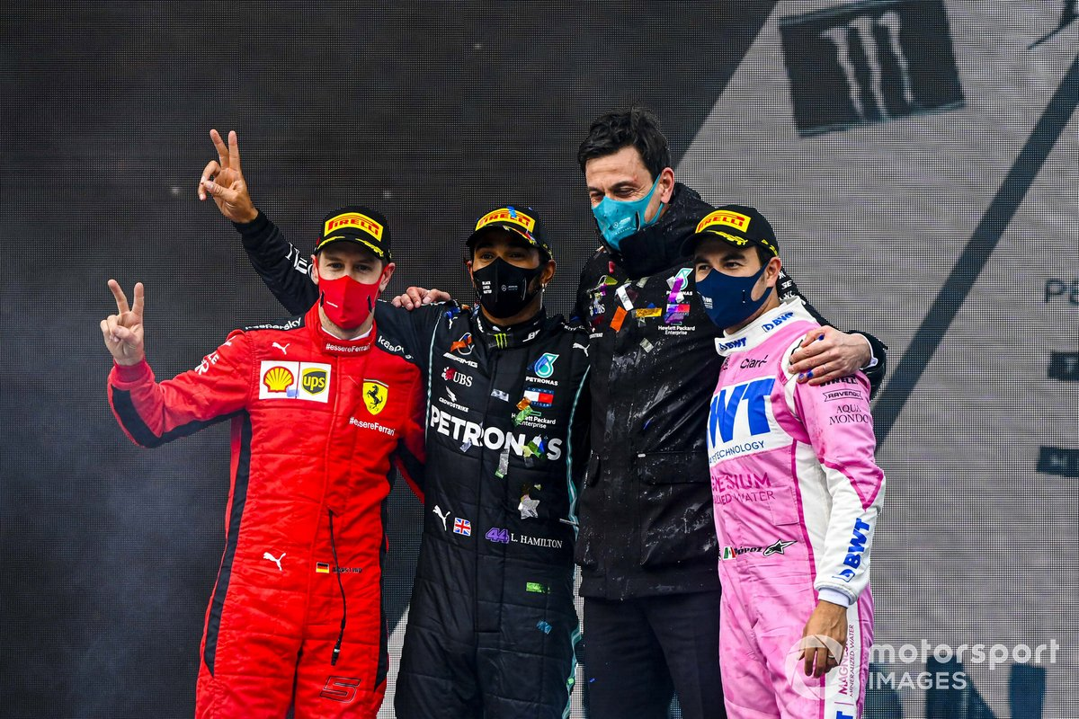 Sebastian Vettel, Ferrari, 3rd position, Lewis Hamilton, Mercedes-AMG F1, 1st position, Toto Wolff, Executive Director (Business), Mercedes AMG, and Sergio Perez, Racing Point, 2nd position, on the podium