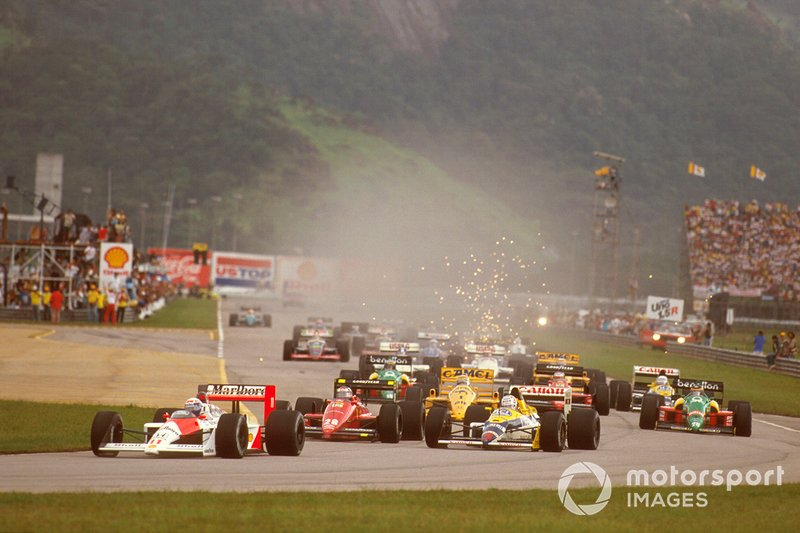 Alain Prost, McLaren MP4/4 Honda, leads Nigel Mansell, Williams FW12 Judd, Gerhard Berger, Ferrari F187/88C