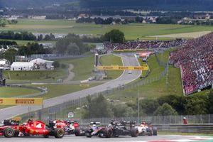 Kimi Raikkonen, Ferrari SF-15T, leads Fernando Alonso, McLaren MP4-30 Honda