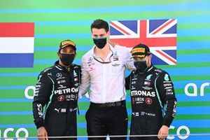 Lewis Hamilton, Mercedes-AMG Petronas F1, 1st position, Valtteri Bottas, Mercedes-AMG Petronas F1, 3rd position, with the Mercedes trophy delegate on the podium