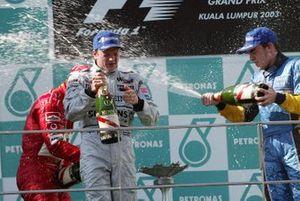 Podium: race winner Kimi Raikkonen, McLaren, third place Fernando Alonso, Renault
