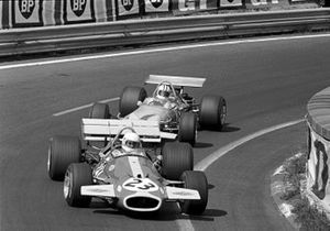 Jack Brabham, Brabham BT33, leads Denny Hulme, Mclaren M14A