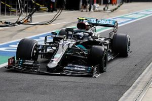 Valtteri Bottas, Mercedes F1 W11 EQ Performance coming in for a pitsop after getting a puncture