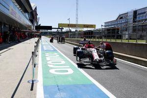 Car of Kimi Raikkonen, Alfa Romeo Racing C39 being pushed down the pit lane