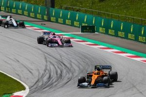 Lando Norris, McLaren MCL35, leads Lance Stroll, Racing Point RP20, and George Russell, Williams FW43