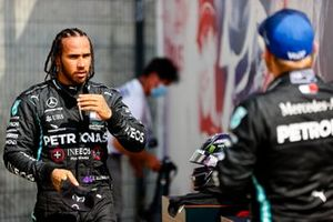 Lewis Hamilton, Mercedes AMG F1, and Valtteri Bottas, Mercedes AMG F1, talk in Parc Ferme