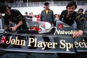 Mario Andretti, Lotus 79 Ford, in the pits overseen by Colin Chapman