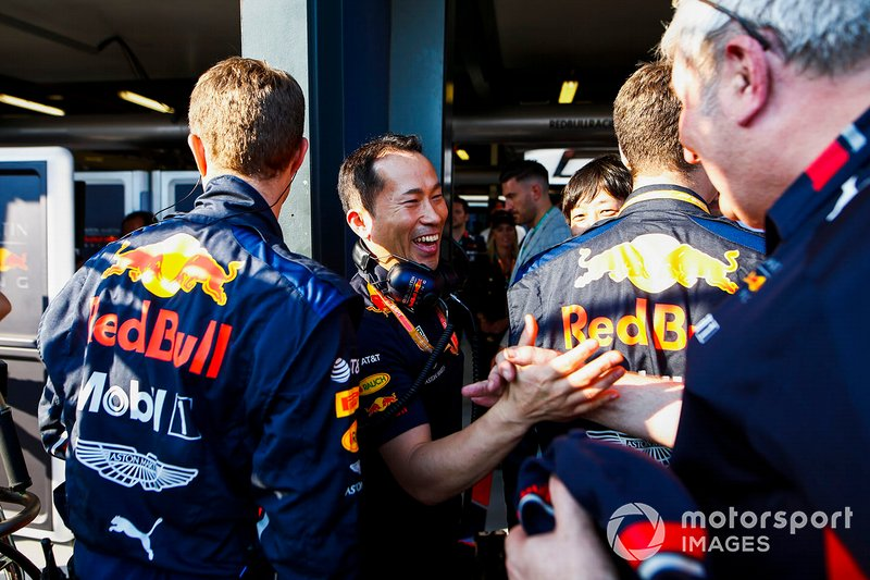 Red Bull team personnel celebrate a podium finish for Max Verstappen, Red Bull Racing