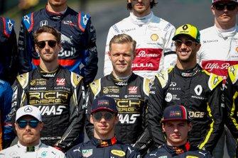 Romain Grosjean, Haas F1, Kevin Magnussen, Haas F1 and Daniel Ricciardo, Renault F1 Team
