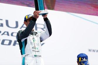 Bandar Alesayi, Saudi Racing, raises his winner's trophy on the podium