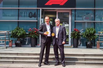 Marin Aleksov, Founder and CEO, Rosland Capital, and Chase Carey, Chairman, Formula 1, present the official F1 1000 coin