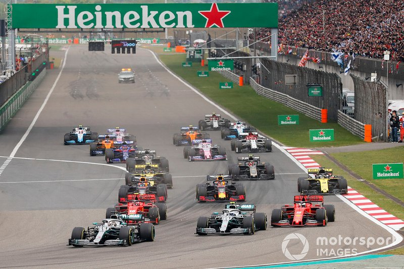Lewis Hamilton, Mercedes AMG F1 W10 leads Valtteri Bottas, Mercedes AMG W10, Sebastian Vettel, Ferrari SF90 and Charles Leclerc, Ferrari SF90 at the start of the race