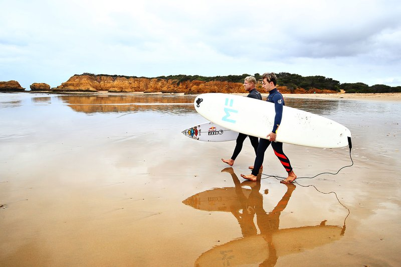 Pierre Gasly, Red Bull Racing poses for a photo after surfing with surf legend Mick Fanning