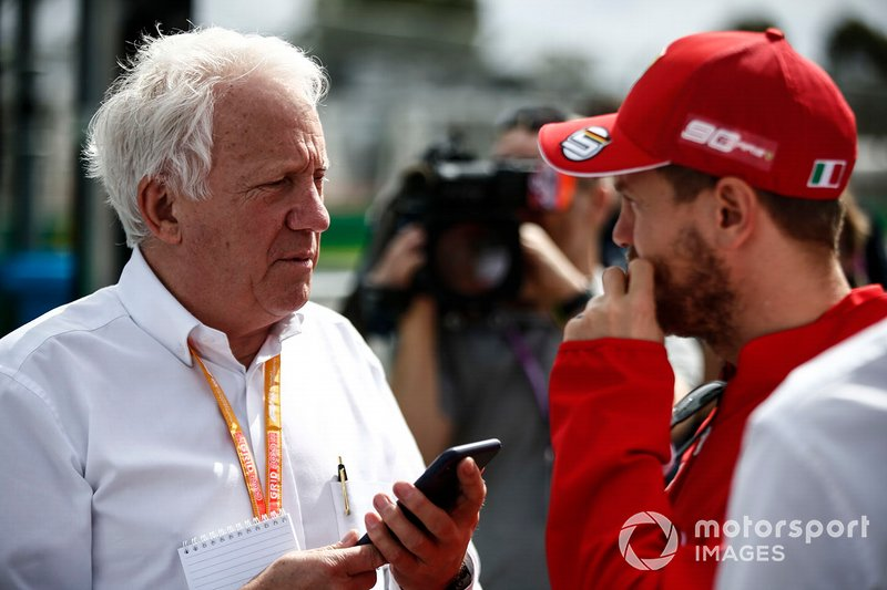 Charlie Whiting, Race Director, FIA, withSebastian Vettel, Ferrari