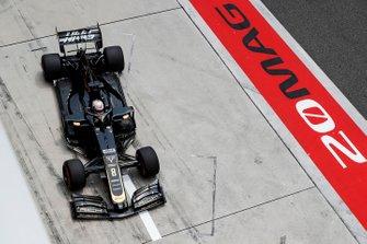 Romain Grosjean, Haas F1 Team VF-19, in the pit lane