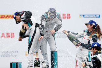 The PRO, PRO AM podiums celebrate with champagne spray