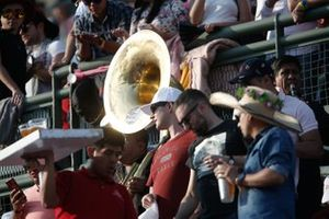 A sousaphone player in the crowd
