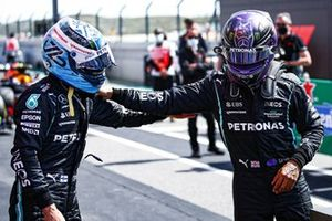 Pole man Valtteri Bottas, Mercedes, is congratulated by his team mate Lewis Hamilton, Mercedes, in Parc Ferme