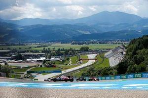 Robert Kubica, Alfa Romeo Racing C41, Valtteri Bottas, Mercedes W12, and Carlos Sainz Jr., Ferrari SF21