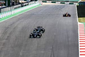 Lewis Hamilton, Mercedes W12, battles with Valtteri Bottas, Mercedes W12