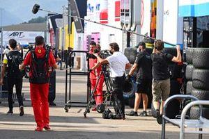 A television film crew follows Daniel Ricciardo, Renault F1, in the paddock