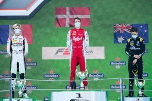 Theo Pourchaire, ART Grand Prix, Race Winner Frederik Vesti, Prema Racing and Oscar Piastri, Prema Racing celebrate on the podium
