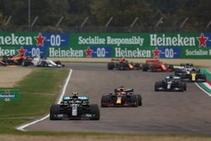 Valtteri Bottas, Mercedes F1 W11, Max Verstappen, Red Bull Racing RB16, Lewis Hamilton, Mercedes F1 W11, and the rest of the field on the opening lap