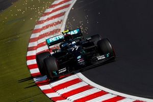Valtteri Bottas, Mercedes F1 W11, kicks up some sparks
