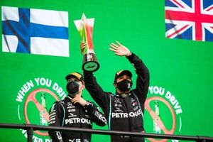 Valtteri Bottas, Mercedes-AMG F1, 2nd position, and Lewis Hamilton, Mercedes-AMG F1, 1st position, with his trophy