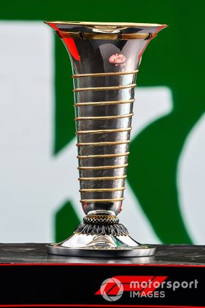 The face of Lewis Hamilton, Mercedes-AMG F1, reflected in the World Championship trophy as he heads towards his 7th World Championship