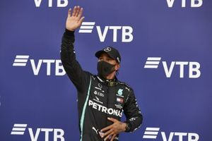 Lewis Hamilton, Mercedes-AMG F1, gives a wave after securing pole