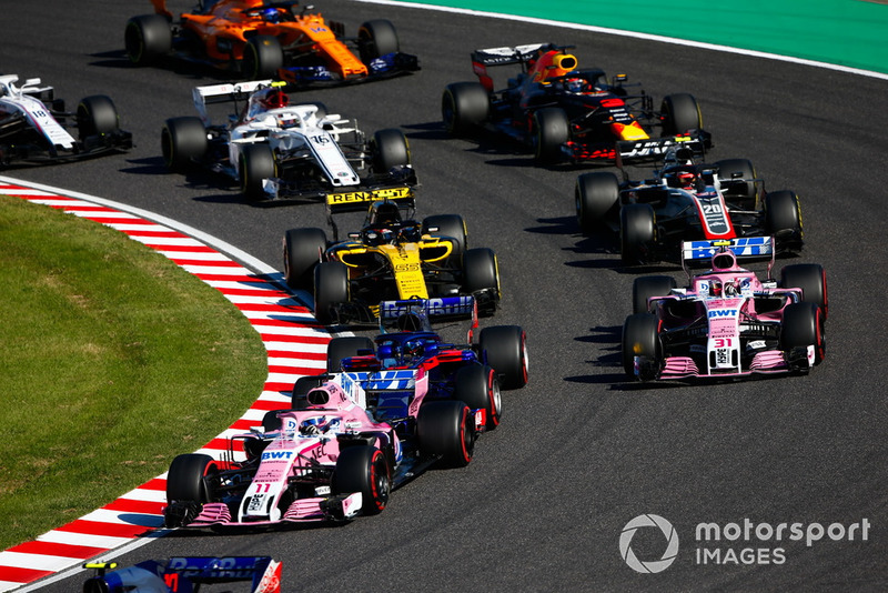 Sergio Perez, Racing Point Force India VJM11, leads Esteban Ocon, Racing Point Force India VJM11, Carlos Sainz Jr., Renault Sport F1 Team R.S. 18, Kevin Magnussen, Haas F1 Team VF-18, Daniel Ricciardo, Red Bull Racing RB14, Charles Leclerc, Sauber C37, Fernando Alonso, McLaren MCL33, and Lance Stroll, Williams FW41, at the start