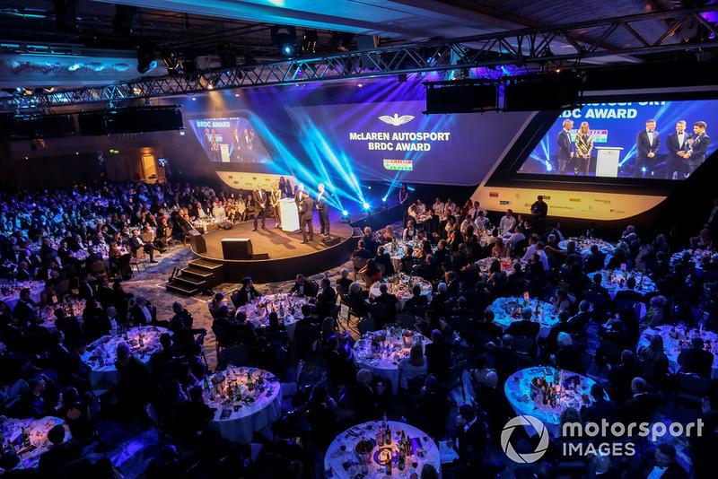 McLaren F1 driver Lando Norris and BTCC driver Jason Plato present the McLaren Autosport BRDC Award on stage