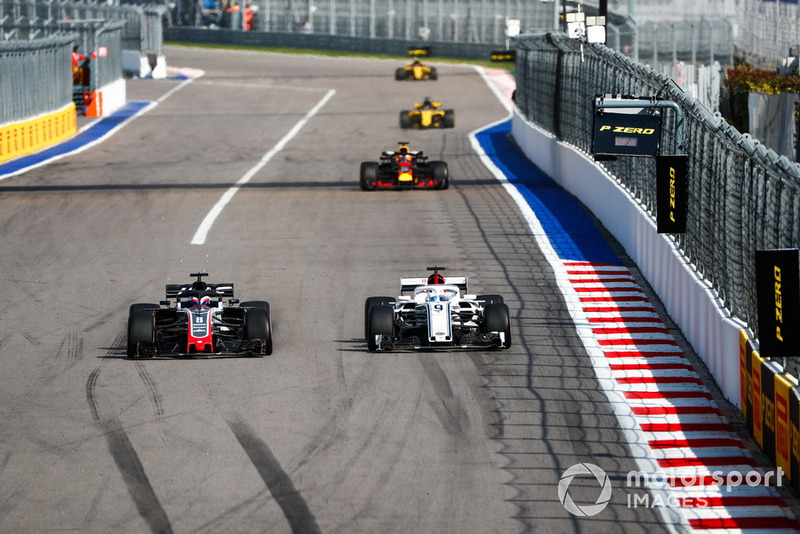 Romain Grosjean, Haas F1 Team VF-18, battles with Marcus Ericsson, Sauber C37