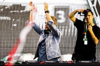 DJ Armin van Buuren plays a set immediately after the podium ceremony