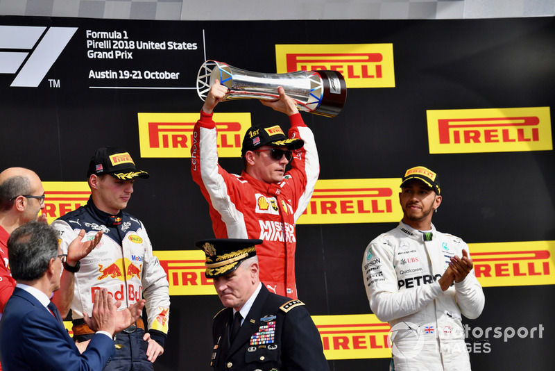 (L to R): Carlo Santi, Ferrari Race Engineer, Max Verstappen, Red Bull Racing, Kimi Raikkonen, Ferrari celebrate with the trophy and Lewis Hamilton, Mercedes AMG F1