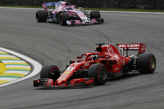 Sebastian Vettel, Ferrari SF71H and Sergio Perez, Racing Point Force India VJM11