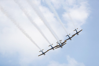 The Embraer EMB 314 Super Tucano's of the Brazilian Air Forces Smoke Squadron fly over the grid