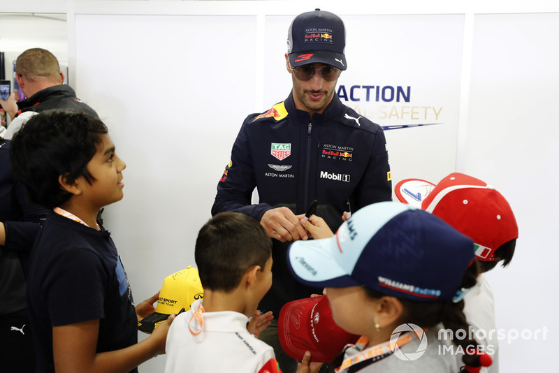 Daniel Ricciardo, Red Bull Racing, signs autographs for some young fans