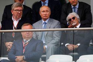 Ross Brawn, Managing Director of Motorsports, FOM, Vladimir Putin, President of Russia, and Bernie Ecclestone, Chairman Emeritus of Formula 1, watch the race