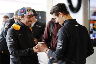Lando Norris, McLaren, brings a cup of tea for Fernando Alonso, McLaren.