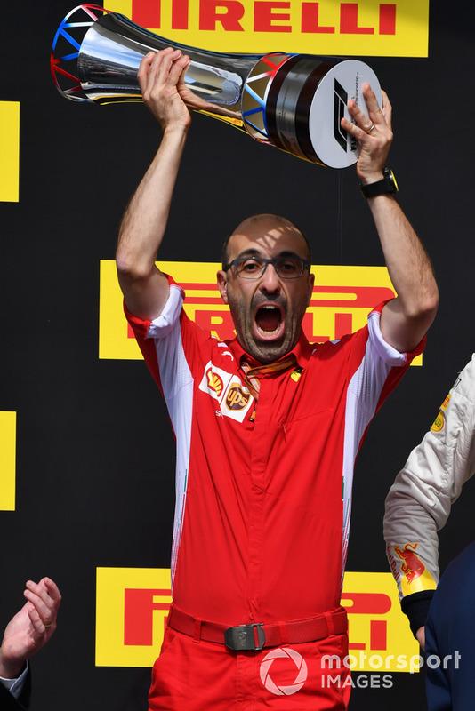 Carlo Santi, Ferrari Race Engineer celebrates on the podium with the trophy