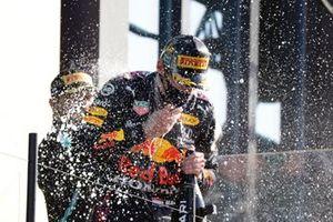 Valtteri Bottas, Mercedes, 3rd position, sprays Champagne at Max Verstappen, Red Bull Racing, 1st position, on the podium